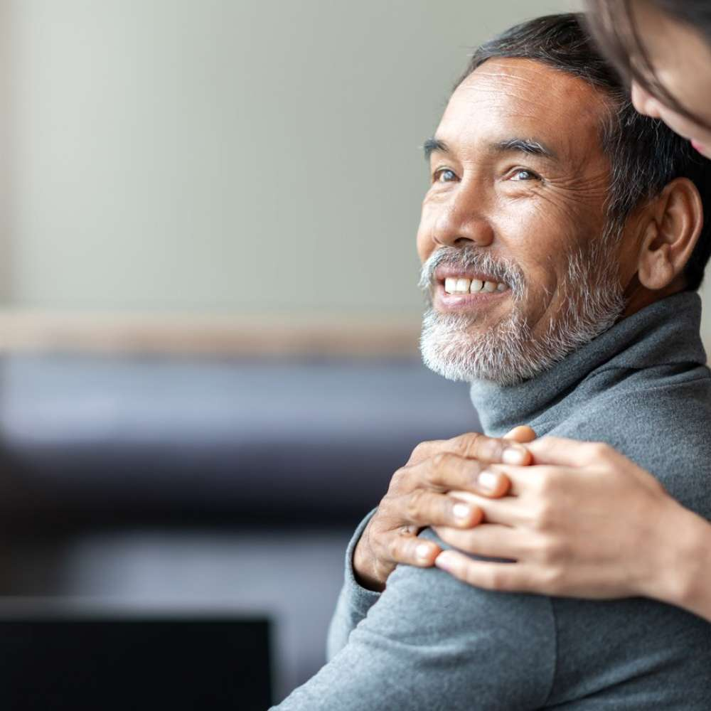 elderly-man-helped-by-daughter